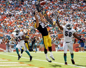 MIAMI - OCTOBER 24: Tight end Matt Spaeth #89 cannot make a touchdown catch against defenders Yeremiah Bell #37 and Karlos Dansby #58 of the Miami Dolphins at Sun Life Stadium on October 24, 2010 in Miami, Florida.  (Photo by Marc Serota/Getty Images)