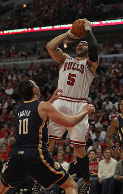 CHICAGO, IL - APRIL 16: Carlos Boozer #5 of the Chicago Bulls puts up a shot over Jeff Foster #10 of the Indiana Pacers in Game One of the Eastern Conference Quarterfinals in the 2011 NBA Playoffs at the United Center on April 16, 2011 in Chicago, Illinoi