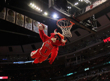 CHICAGO, IL - APRIL 18: Chicago Bulls mascot Benny the Bull leaps for a dunk during a time-out between the Bulls and the Indiana Pacers in Game Two of the Eastern Conference Quarterfinals in the 2011 NBA Playoffs at the United Center on April 18, 2011 in