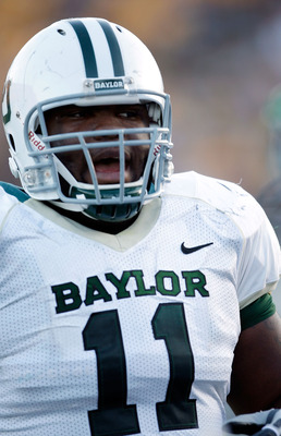 COLUMBIA, MO - NOVEMBER 07:  Defensive tackle Phil Taylor #11 of the Baylor Bears watches from the bench during the game against the Missouri Tigers at Faurot Field/Memorial Stadium on November 7, 2009 in Columbia, Missouri.  (Photo by Jamie Squire/Getty
