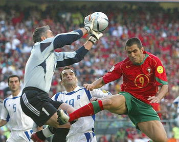 Antonios Nikopolidis beats Pauleta to the ball in the Euro 2004 final