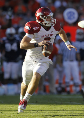 AUBURN, AL - OCTOBER 16:  Quarterback Tyler Wilson #8 of the Arkansas Razorbacks rolls out and looks downfield for a receiver during the game against the Auburn Tigers at Jordan-Hare Stadium on October 16, 2010 in Auburn, Alabama.  The Tigers beat the Raz