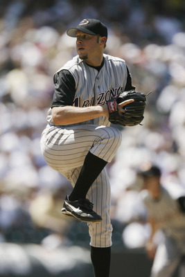 DENVER - JULY 18:  Pitcher Brian Anderson #34 of the Arizona Diamondbacks winds up during the MLB game against the Colorado Rockies on July 18, 2002 at Coors Field in Denver, Colorado.  The Rockies won 6-4.  (Photo by Brian Bahr/Getty Images)