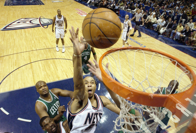 EAST RUTHERFORD, NJ - MAY 7:  Kenyon Martin #6 of the New Jersey Nets shoots past Antoine Walker #8 of the Boston Celtics in Game two of the Eastern Conference Semifinals during the 2003 NBA Playoffs on May 7, 2003 at Continental Airlines Arena in East Ru