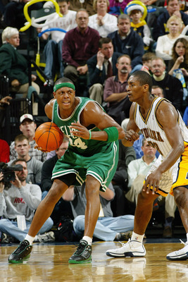 INDIANAPOLIS - NOVEMBER 11:  Paul Pierce #34 of the Boston Celtics looks to play the ball against Ron Artest #23 of the Indiana Pacers during the game at Conseco Fieldhouse on November 11, 2003 in Indianapolis, Indiana.  The Celtics won 78-76.  NOTE TO US