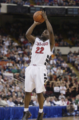 PITTSBURGH - MARCH 17:  Steve Logan #22 of the Cincinnati Bearcats shoots a jump shot during the second round of the 2002 NCAA Division I Men's Basketball Tournament on March 17, 2002 against the UCLA Bruins at Mellon Arena in Pittsburgh, Pennsylvania.  T