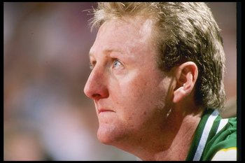 DENVER - 1990:  Boston Celtics forward Larry Bird #33 looks on from the bench during game against the Denver Nuggets at McNichols Arena in Denver, Colorado. (Photo by Allsport  /Allsport