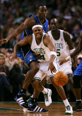 BOSTON - NOVEMBER 20: Paul Pierce #34 of the Boston Celtics tries to move the ball against the defense of Dwight Howard #12 of the Orlando Magic during the game on November 20, 2009 at the TD Garden in Boston, Massachusetts. NOTE TO USER: User expressly a