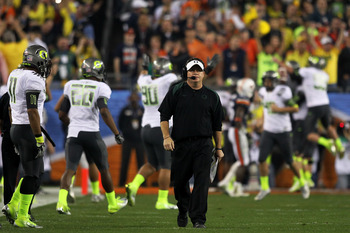 GLENDALE, AZ - JANUARY 10:  Head coach Chip Kelly of the Oregon Ducks waslks down the sideline after his Ducks scored a second quater touchdown against the Auburn Tigers in the Tostitos BCS National Championship Game at University of Phoenix Stadium on Ja