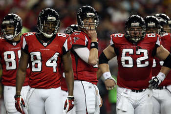 ATLANTA, GA - JANUARY 15:  (L-R) Tony Gonzalez #88, Roddy White #84, Matt Ryan #2 and Todd McClure #62 of the Atlanta Falcons look on against the Green Bay Packers during their 2011 NFC divisional playoff game at Georgia Dome on January 15, 2011 in Atlant