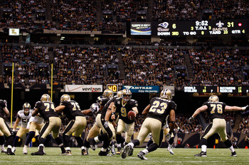 NEW ORLEANS, LA - DECEMBER 12:  Drew Brees #9 of the New Orleans Saints looks to hand the ball off during the game against the St. Louis Rams at the Louisiana Superdome on December 12, 2010 in New Orleans, Louisiana. The Saints defeated the Rams 31-13.  (