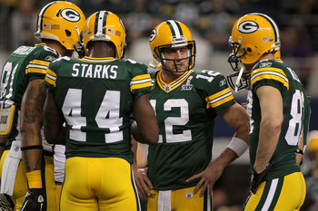 ARLINGTON, TX - FEBRUARY 06:  Aaron Rodgers #12 of the Green Bay Packers talks to teammates prior to their game against the Pittsburgh Steelers during Super Bowl XLV at Cowboys Stadium on February 6, 2011 in Arlington, Texas.  (Photo by Doug Pensinger/Get