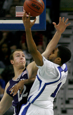 NEW ORLEANS - MARCH 18:  Nick Fazekas #22 of the Nevada Wolf Pack and Chris Douglas-Roberts #14 of the Memphis Tigers clash during round two of the NCAA Men's Basketball Tournament at the New Orleans Arena on March 18, 2007 in New Orleans, Louisiana.  (Ph