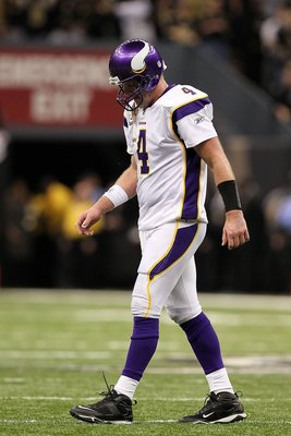 NEW ORLEANS - JANUARY 24:  Quarterback Brett Favre #4 of the Minnesota Vikings walks towards the sidelin with his head down against the New Orleans Saints during the NFC Championship Game at the Louisiana Superdome on January 24, 2010 in New Orleans, Loui