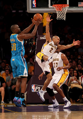 LOS ANGELES, CA - APRIL 17:   Emeka Okafor #50 of  the New Orleans Hornets controls the ball against Derek Fisher #2 of the Los Angeles Lakers in Game One of the Western Conference Quarterfinals in the 2011 NBA Playoffs on April 17, 2011 at Staples Center