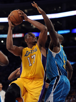 LOS ANGELES, CA - APRIL 20:  Andrew Bynum #17 of the Los Angeles Lakers goes up for a shot against Emeka Okafor #50 of the New Orleans Hornets in Game Two of the Western Conference Quarterfinals in the 2011 NBA Playoffs on April 20, 2011 at Staples Center