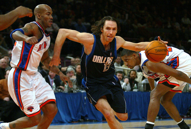NEW YORK CITY - JANUARY 12:  Steve Nash #13 of the Dallas Mavericks drives past Stephon Marbury #3 and Kurt Thomas #40 of the New York Knicks on January 12, 2004 at Madison Square Garden in New York City. NOTE TO USER: User expressly acknowledges that, by