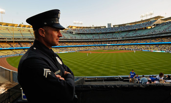 LOS ANGELES, CA - APRIL 14:  A Los Angeles Police Department officer looks out from an outfield pavillion at Dodger Stadium prior to the start of the baseball game between the St. Louis Cardinals and Los Angeles Dodgers on April 14, 2011 in Los Angeles, C