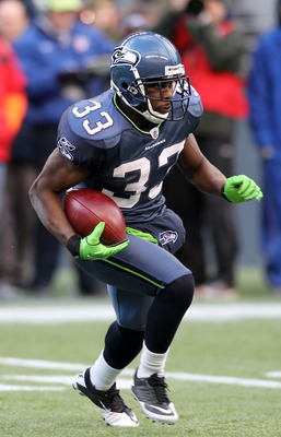 SEATTLE, WA - JANUARY 08:  Leon Washington #33 of the Seattle Seahawks runs down field against the New Orleans Saints during the 2011 NFC wild-card playoff game at Qwest Field on January 8, 2011 in Seattle, Washington.  (Photo by Jonathan Ferrey/Getty Ima