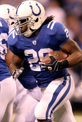 INDIANAPOLIS, IN - JANUARY 08:  Joseph Addai #29 of the Indianapolis Colts runs the ball against the New York Jets during their 2011 AFC wild card playoff game at Lucas Oil Stadium on January 8, 2011 in Indianapolis, Indiana. The Jets won 17-16. (Photo by
