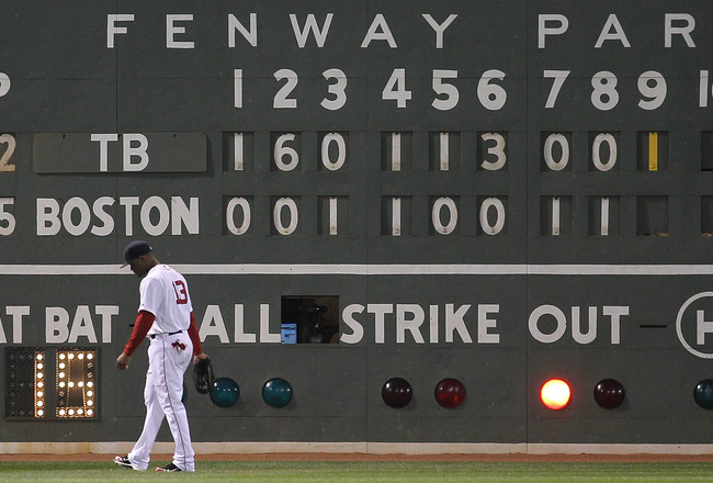 BOSTON, MA - APRIL 11:  Carl Crawford #13 of the Boston Red Sox walks into position during a game against the Tampa Bay Rays at Fenway Park April 11, 2011 in Boston, Massachusetts. (Photo by Jim Rogash/Getty Images)