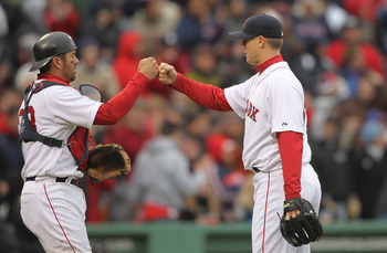 BOSTON, MA - APRIL 16, 2011:  Jonathan Papelbon #58 and Jason Varitek #33 of the Boston Red Sox celebrate a win against the Toronto Blue Jays at Fenway Park April 16, 2011 in Boston, Massachusetts. (Photo by Jim Rogash/Getty Images)