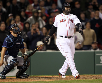 BOSTON, MA - APRIL 12:  David Ortiz #34 of the Boston Red Sox flies out in the ninth inning as Kelly Shoppach #10 of the Tampa Bay Rays stands by on April 12, 2011 at Fenway Park in Boston, Massachusetts. The Tampa Bay Rays defeated the Boston Red Sox 3-2