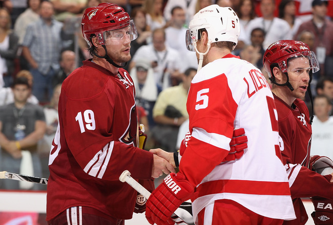 GLENDALE, AZ - APRIL 20:  Captains Shane Doan #19 of the Phoenix Coyotes and Nicklas Lidstrom #5 of the Detroit Red Wings shake hands following Game Four of the Western Conference Quarterfinals during the 2011 NHL Stanley Cup Playoffs at Jobing.com Arena