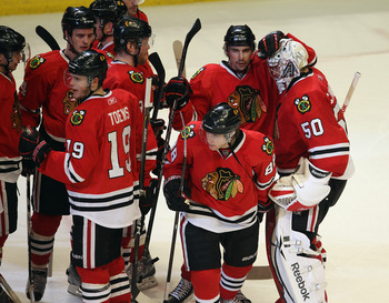 CHICAGO, IL - APRIL 19: Corey Crawford #50 of the Chicago Blackhawks is congratulated by teammates after a win over the Vancouver Canucks in Game Four of the Western Conference Quarterfinals during the 2011 NHL Stanley Cup Playoffs at the United Center on
