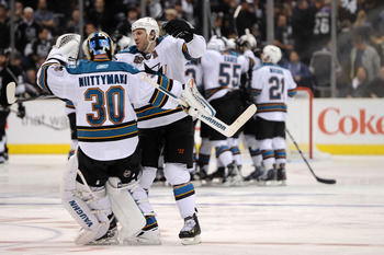 LOS ANGELES, CA - APRIL 19:  Antero Niittymaki #30 and Ryane Clowe #29 of the San Jose Sharks celebrate their 6-5 win over the Los Angeles Kings in overtime of game three of the Western Conference Quarterfinals during the 2011 NHL Stanley Cup Playoffs at