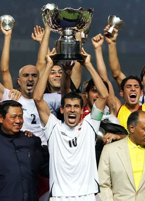 Iraq captain Younis Mahmoud lifts the trophy that helped unite a nation