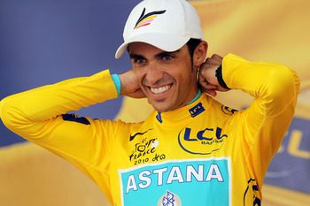 BORDEAUX, FRANCE - JULY 23: Cyclist Alberto Contador stands on the podium as he is presented with the yellow jersey at the conclusion of stage 18 of the Tour de France on July 23, 2010 in Bordeaux, France. England�s Mark Cavendish won the stage while Span
