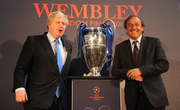LONDON, ENGLAND - APRIL 20:  UEFA President Michel Platini hands over the UEFA Champions League Trophy to the Mayor of London Boris Johnson at the Guildhall on April 20, 2011 in London, England.  (Photo by Jamie McDonald/Getty Images)