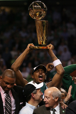 BOSTON - JUNE 17:  Paul Pierce #34 of the Boston Celtics celebrates with the Larry O'Brien Trophy after defeating the Los Angeles Lakers in Game Six of the 2008 NBA Finals on June 17, 2008 at TD Banknorth Garden in Boston, Massachusetts. NOTE TO USER: Use