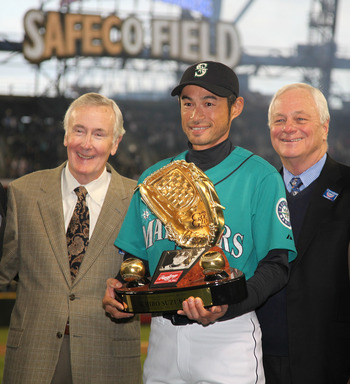 SEATTLE - APRIL 08:  Right fielder Ichiro Suzuki #51 of the Seattle Mariners is flanked by CEO Howard Lincoln (L) and COO Chuck Armstrong as he receives his Gold Glove Award prior to the Seattle Mariners' home opener against the Cleveland Indians at Safec