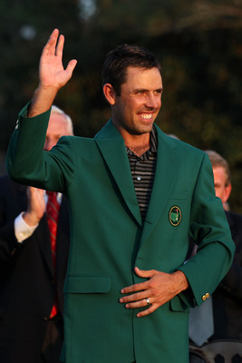 AUGUSTA, GA - APRIL 10:  Charl Schwartzel of South Africa waves to the gallery at the green jacket presentation after his two-stroke victory at the 2011 Masters Tournament at Augusta National Golf Club on April 10, 2011 in Augusta, Georgia.  (Photo by And