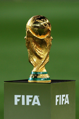 JOHANNESBURG, SOUTH AFRICA - JULY 11:  The World Cup presented on the pitch ahead of the 2010 FIFA World Cup South Africa Final match between Netherlands and Spain at Soccer City Stadium on July 11, 2010 in Johannesburg, South Africa.  (Photo by Clive Ros