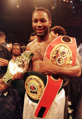 29 Apr 2000: Heavyweight champion Lennox Lewis holds his belts after defeating Michael Grant in the second round of their WBC/IBF Heavyweight fight at Madison Square Garden in New York City. Lewis won by TKO in the second round. Mandatory Credit: Al Bello