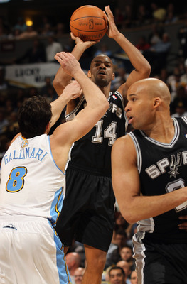 DENVER, CO - MARCH 23:  Gary Neal #14 of the San Antonio Spurs takes a shot over Danilo Gallinari #8 of the Denver Nuggets as Richard Jefferson #24 of the Spurs follows the play at the Pepsi Center on March 23, 2011 in Denver, Colorado. NOTE TO USER: User