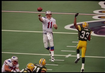 26 Jan 1997: Quarterback Drew Bledsoe of the New England Patriots passes the ball during Super Bowl XXXI against the Green Bay Packers at the Superdome in New Orleans, Louisiana. The Packers won the game, 35-21.