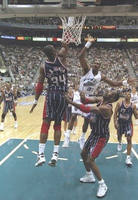 21 May 1997:  Forward Karl Malone of the Utah Jazz and center Hakeem Olajuwon and forward Kevin Willis of the Houston Rockets jump for the ball during a playoff game at the Delta Center in Salt Lake City, Utah.  The Jazz won the game 104-92. Mandatory Cre