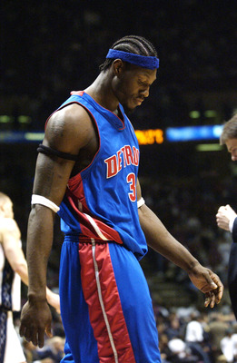 EAST RUTHERFORD, NJ - MAY 22:  Ben Wallace #3 of the Detroit Pistons heads to the bench during the fourth quarter of game three of the Eastern Conference Finals during the 2003 NBA Playoffs against the New Jersey Nets on May 22, 2003 at Continental Airlin