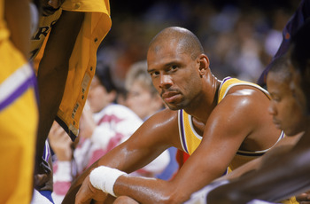 LOS ANGELES - 1987:  Kareem Abdul-Jabbar #33 of the Los Angeles Lakers sits on the bench during an NBA game at the Great Western Forum in Los Angeles, California in 1987. (Photo by: Mike Powell/Getty Images)