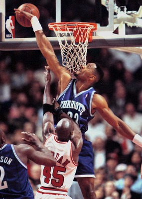 4 MAY 1995:  CHARLOTTE HORNET CENTER ALONZO MOURNING SLAPS AWAY A SHOT BY CHICAGO BULL MICHAEL JORDAN SHOT  DURING FIRST QUARTER ACTION OF GAME FOUR IN NBA FIRST ROUND PLAY-OFF ACTION BETWEEN THE TWO TEAMS AT THE UNITED CENTER IN CHICAGO, ILLINOIS. Mandat