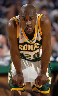 SEATTLE- APRIL 27:  Point guard Gary Payton #20 of the Seattle SuperSonics rests during game three of the Western Conference quarterfinals series against the San Antonio Spurs during the 2002 NBA Playoffs at Key Arena in Seattle, Washington on April 27, 2