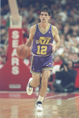 17 Dec 1994: Guard John Stockton of the Utah Jazz moves the ball during a game against the Chicago Bulls at the United Center in Chicago, Illinois. The Jazz won the game, 97-89.