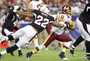 GLENDALE, AZ - SEPTEMBER 02:  Wide receiver Brandon Banks #16 of the Washington Redskins runs with the ball after a reception past Matt Ware #22 of the Arizona Cardinals during preseason NFL game at the University of Phoenix Stadium on September 2, 2010 i