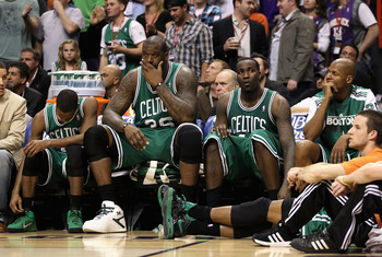 PHOENIX, AZ - JANUARY 28:  (L-R) Rajon Rondo #9, Shaquille O'Neal #36, Kendrick Perkins #43 and Ray Allen #20 of the Boston Celtics react while sitting on the bench during the NBA game against the Phoenix Suns at US Airways Center on January 28, 2011 in P