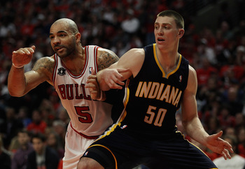 CHICAGO, IL - APRIL 16: Carlos Boozer #5 of the Chicago Bulls and Tyler Hansbrough #50 of the Indiana Pacers battle for position on a free-throw in Game One of the Eastern Conference Quarterfinals in the 2011 NBA Playoffs at the United Center on April 16,