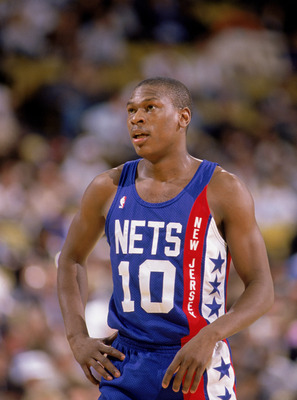 1990:  Mookie Blaylock #10 of the New Jersey Nets stands on the court during an NBA game in 1990. NOTE TO USER: User expressly acknowledges and agrees that, by downloading and/or using this Photograph, User is consenting to the terms and conditions of the